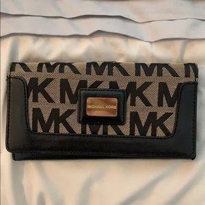 Black and beige Michael Kors wallet